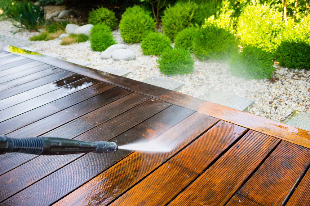 Wooden Deck Getting Pressure Washed to Look Like New
