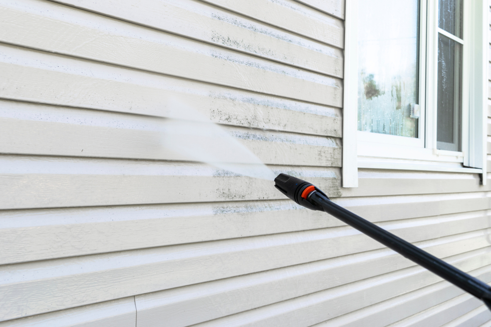 Will Pressure Washing Strip off my Home's Paint